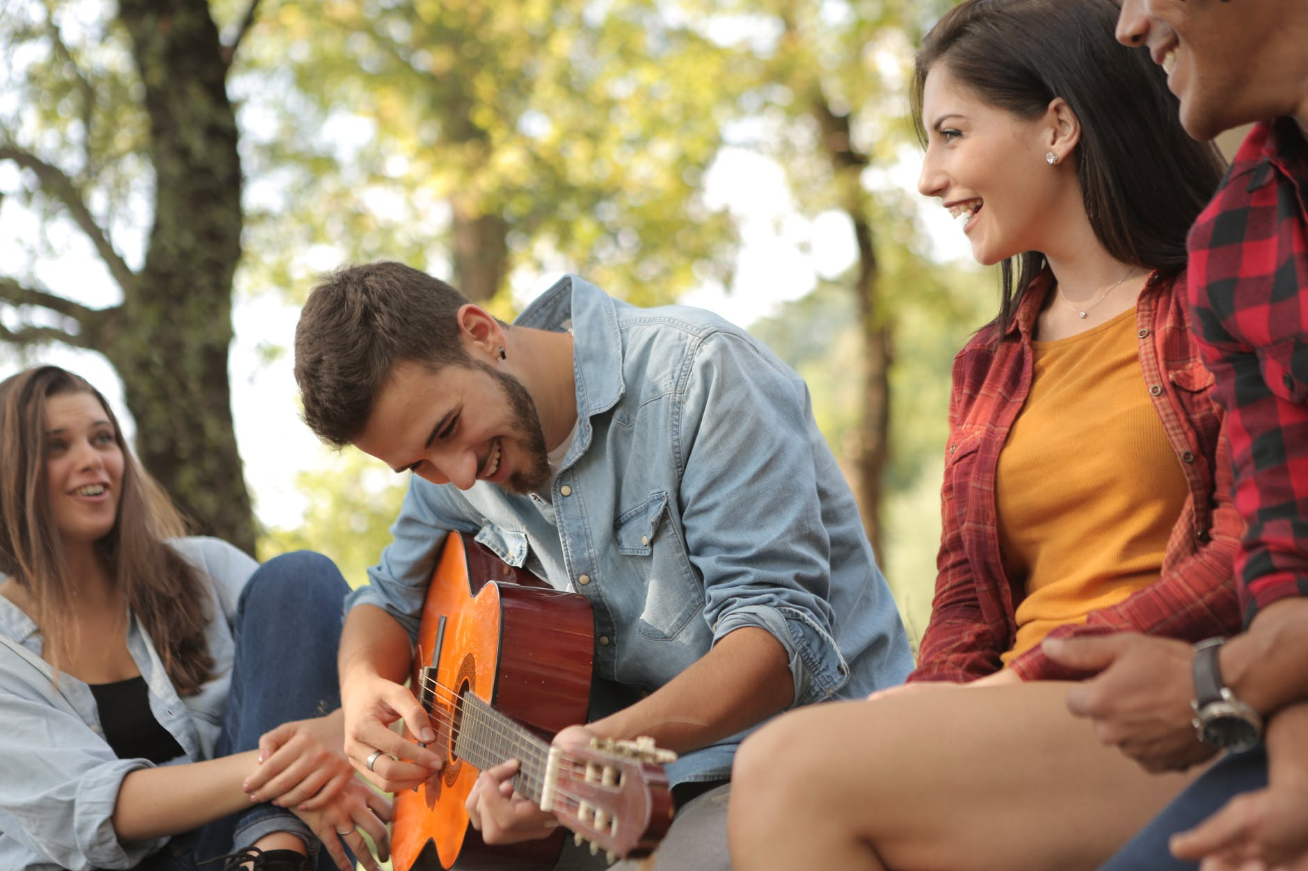 friends spending time together with guitar